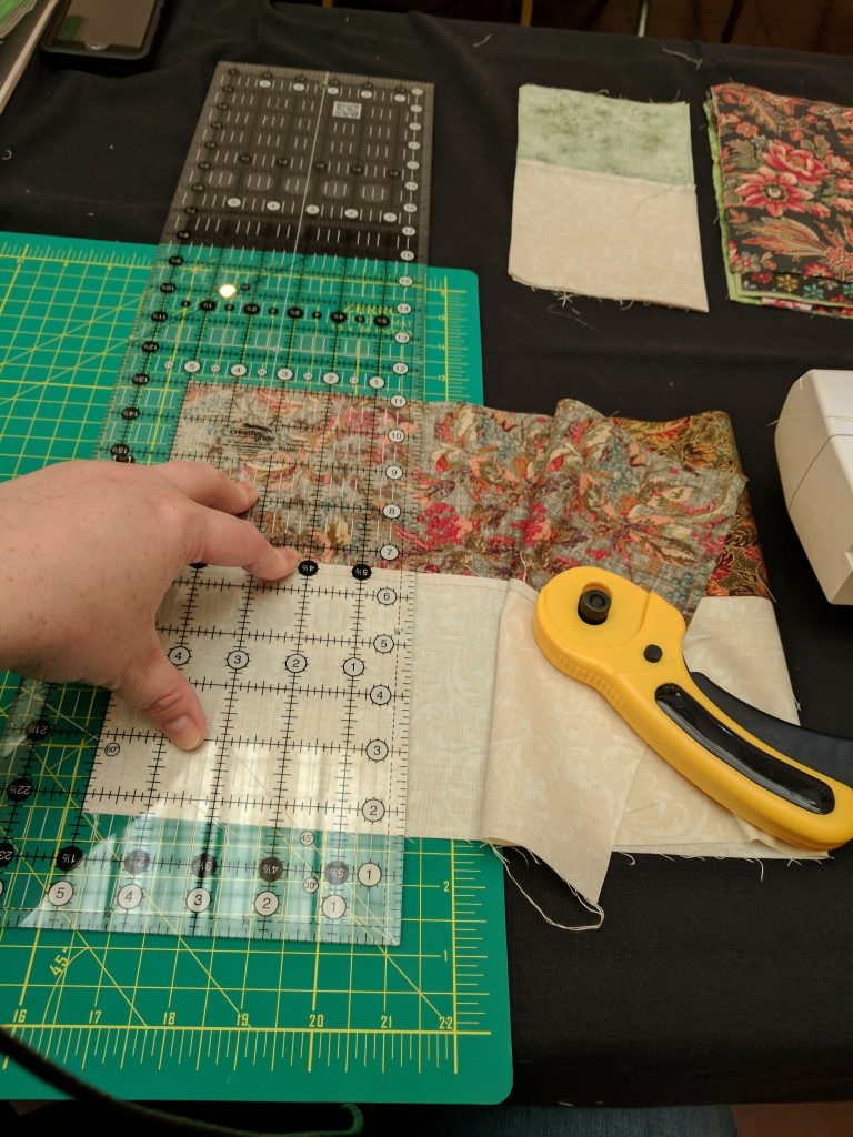 Measuring fabric before cutting.