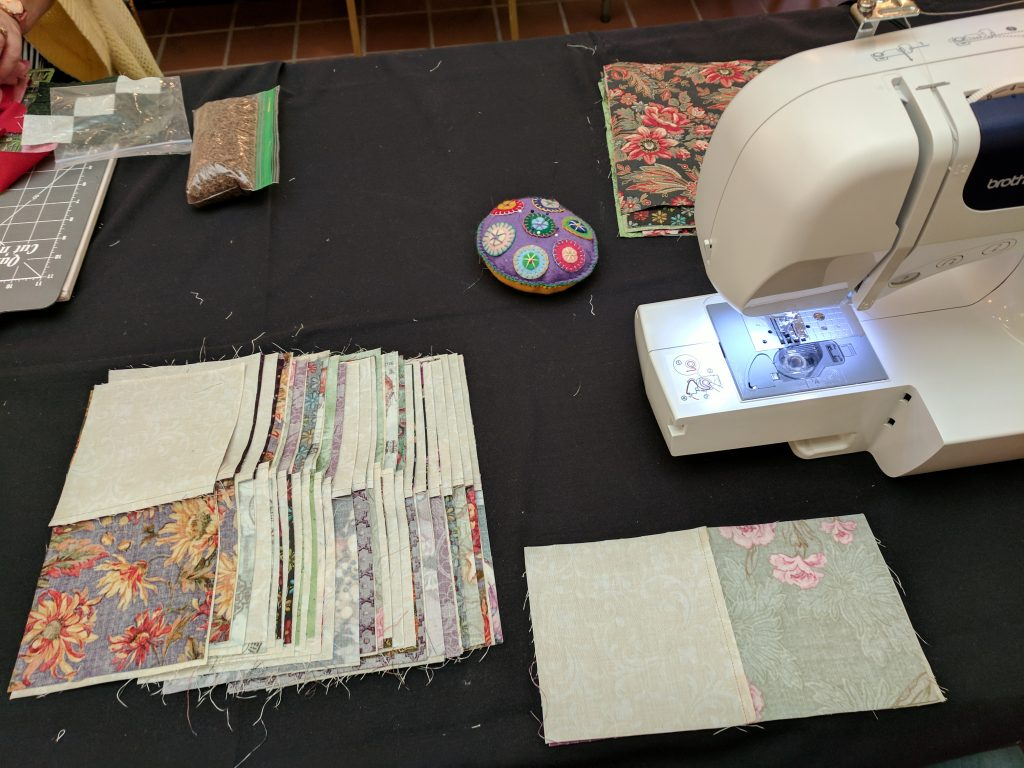 Sewing section into quilt blocks.