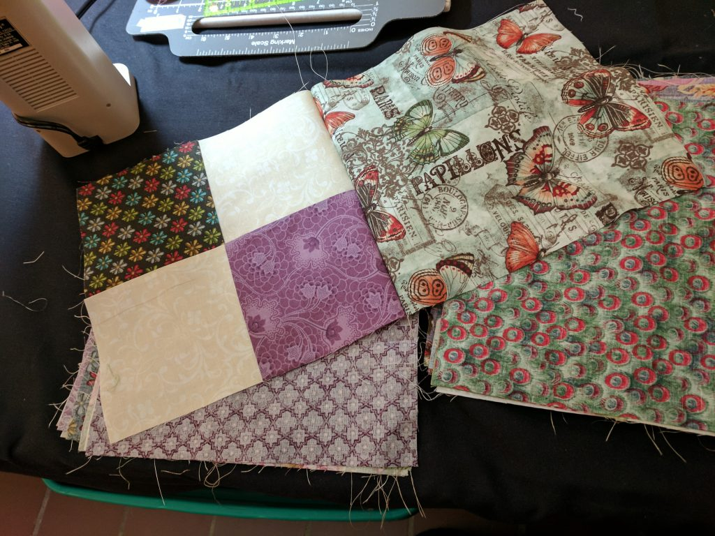 Two quilt blocks sewn together.